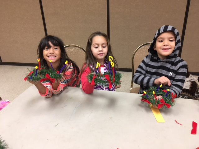 Faith Formation students learning about Advent and creating wreaths