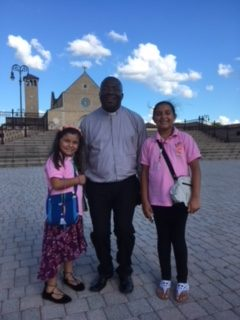 Father Nazaire with 2 little pilgrims